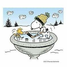 Snoopy and Woodstock playing hockey on frozen birdbath