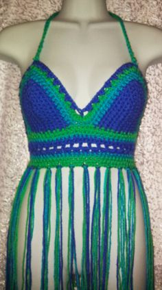 Check out this item in my Etsy shop https://www.etsy.com/listing/184459242/peacock-inspired-crochet-hippie-top