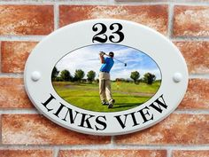 Ceramic Style house plaque with a Golfer on golf course design created from original artwork. This house plate is made from solid cultured marble and is designed to give the look . Name Plates For Home, House Plaques, Golf Theme, House Names, House Signs, Ceramic Houses, Sign Printing, Print Pictures, Fashion Pictures