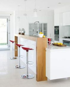 Home made of glass: nice clean kitchen white caesar stone benchtops/american walnut bf bar/kuppersbusch oven/liebherr fridge