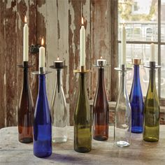 We have the perfect excuse for you to drink more wine. Reuse your wine bottles and make unique candle decor with the help of our #bottelabra candle holders! #candles #northernlightscandles #wine #winter #reuse #recycle #homedecor