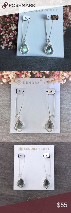 NWT Kendra Scott Carrine Suspended Black Pearl Pretty clear faceted crystal with a touch of oil slick rainbow all suspended on a delicate silver wire! Accent any outfit with a beautiful bit of sparkle! Add to your collection or start a new one! Perfect condition, never worn! Kendra Scott Jewelry Earrings