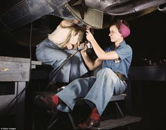 Two women make sure a bomber is up to scratch at the Douglas Aircraft Company in Long Beac...