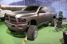 Lifted matte black Ram with UnderCover Classic bed cover