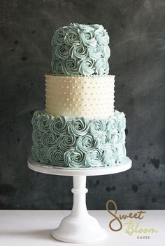 Beautiful blue rosette and white pearl decorated wedding cake www.sweetbloomcakes.com.au/
