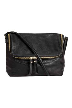 Shoulder bag in grained imitation leather. Flap with zip, narrow adjustable shoulder strap, and one inner compartment with zip. Size 3 x 7 x 9 in. H&m Fashion, Fashion Bags, Fashion Accessories, Small Shoulder Bag, Leather Shoulder Bag, Shoulder Strap, H&m Handbags, Leather Handbags, Shopping