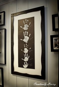 Hand print display of family... ( you could always add the dog and cat paw prints too )