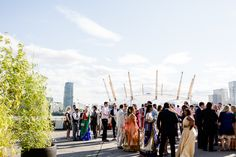 A Vibrant Hindu Wedding at Trinity Bouy Wharf London. The city skyline & the Millenium Dome as a backdrop. Photo by Lydia Stamps Photography London Wedding, Backdrops, Dolores Park, Wedding Flowers, Wedding Venues, Stamps, Vibrant, Skyline, Street View