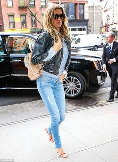 Street chic: The former Victoria's Secret Angel went effortlessly cool with a vintage blac...