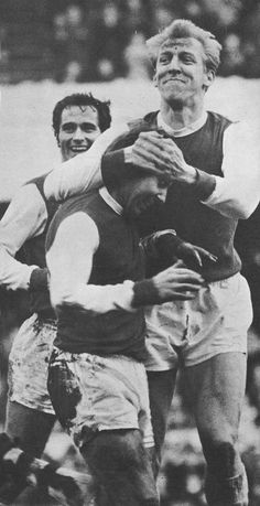 26th December 1968. Arsenal centre half Ian Ure celebrates with centre forward David Court following his spectacular goal against Manchester United, at Highbury.