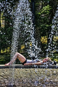 Student relaxes on the Academic Mall fountain. Photo by John Griffin/Office of Communications Stony Brook University, Long Island, Fountain, Students, Spring, Places, Outdoor Decor, Water Fountains, Lugares