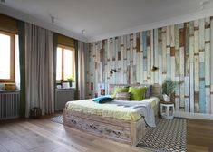 An eclectic apartment in Moscow - very rustic bedroom with a vertical wood panelled feature wall look.