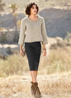 The insouciant, bell-shaped pullover is full-fashion knit of fluffy, homespun…