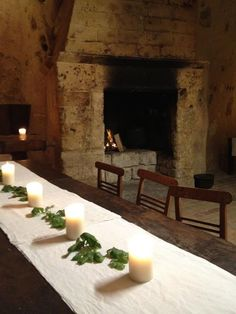 Dinner by candle and firelight in the deconsecrated church, Sextantio cave hotel - Le Grotte dell Civita, Matera Italy  as seen on linenandl...