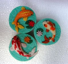Koi Fish and Water Lily cupcake toppers Fish Cupcakes, Fish Cookies, Fondant Cupcake Toppers, Cupcake Cakes, Koi, Pond Cake, Kawaii Cooking, Chinese Cake, New Year's Desserts
