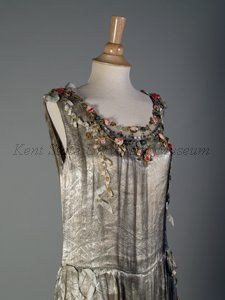 Dress: Boué Soeurs Signed. Date1928, Culture French Description Brocade silver lame, blue net, silk floral trim, sequins. Chemise style, sleeveless, dropped waist, net trim at hem. Detaile