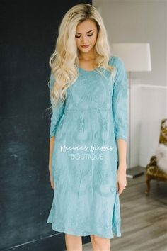 Meet your new favorite dress! Our Day Dreamer dress is fully lined, has 3/4 length sleeves, a relaxed fit and the overlay is this beautiful lake blue crochet lace.