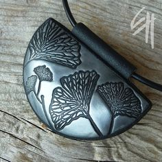 use rubber ginkgo leaf stamp to add texture to bowls, vases, plaques