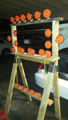 3 tier pigeon clay target stand. Made under 30 min with thrown out pellet wood. Bought this strong plastic clothes pins from Walmart to hold the clays and nailed them on
