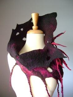 wild design...peek-a-boo holes and long stringy bits...just great felted neck warmer