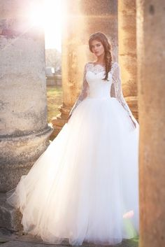 Romantic Puffy Ball Gown Wedding Dresses 2017 Lace Appliques Long Sleeve Bateau Neck Court Train Tulle Chapel Bridal Gowns New Arrival · · Online Store Powered by Storenvy Sheer Wedding Dress, Stunning Wedding Dresses, Wedding Dress Sleeves, Tulle Wedding, Wedding Dress Styles, Lace Dress, Gown Wedding, Lace Bodice, Puffy Wedding Dresses
