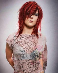 Trendy red emo-style jagged layered hairstyle colored in red and soft streaked with blonde.