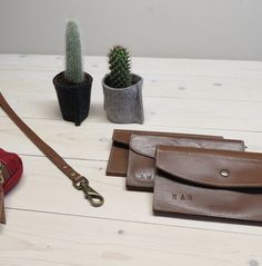 Leather wallets in my studio :) Vegetable tanned leather collection and felt planters for cactus.