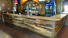 We refaced the bar at the Levee in KC. We used a mixed variety of hardwoods reclaimed from 1800s barns. Its so pretty now!