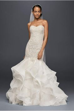 This beautiful wedding dress is a special value, with an emphasis on special. You\'ll feel admired and simply magnificent when you slip into the satin bodice, chapel train, and lavish organza ball gow