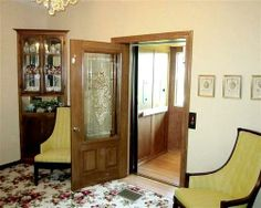 Home Elevator Photo Gallery - Country Home Elevator - Symmetry 2-stop home elevator installed in Houston, Missouri.  Single entry cab Clear Plexiglass car gate with power opener Oak shaker style trim Glass cab wall looks out on Missouri countryside through hoistway windows