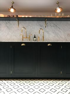 Bespoke kitchen by 202 design with Queens Park Design & Build. Painted Shaker, farrow & Ball Railings, Carrara Marble, brass, Lacanche range, solid Oak. Waterworks Brass Tap
