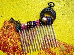 I think a lot of folks are looking at Alice in Wonderland and White Rabbit themed halloween costumes, as those search terms keep sending folks to this hand beaded steampunk-inspired rainbow hair comb! It's on Etsy, but may not be for much longer...