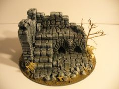 Ruined building for game terrain.  Benson builds his own but it is interesting that you can buy terrain from etsy.  This piece is available for $30.