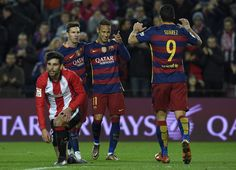 Barcelona's Brazilian forward Neymar (2ndR) celebrates with Barcelona's Argentinian forward Lionel Messi (2ndL) and Barcelona's Uruguayan forward Luis Suarez (R) after scoring during the Spanish league football match FC Barcelona vs Athletic Club Bilbao at the Camp Nou stadium in Barcelona on January 17, 2016.