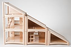 Stackable doll house.  It makes the size and configuration possibilities endless.