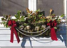 Pretty winter window box. Love the pearls!