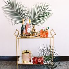 Pink drinks and palm trees. Yes please   by @houseofhome_au #drinkstrolley #barcart #pinkdrinks #palmtrees #wishitwasfriday #elliotlifestyle