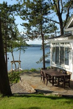 Dining outside is a Must at a Lakeside House