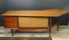 An amazing, large mid century teak and walnut boomerang desk in excellent vintage condition. Caning covered partial back, 2 drawers and pull out writing surface. Cleaned, oiled, repaired and relove…