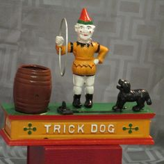 Antique Clown & Trick Dog Mechanical Cast Iron Piggy Bank - https://www.etsy.com/listing/182320767/antique-clown-trick-dog-mechanical-cast