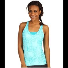North Face Tadasana Workout Top North Face workout/sport top with built-in bra. Turquoise color with flower print. Top is 22 inches long from shoulder to bottom hem. Does not have tags, but has never been worn. North Face Tops