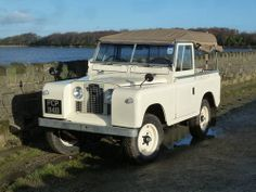 Land Rover Series 2A - (1962). Off roader, white, blue sky, water, road, transportation, wheels, photograph, photo
