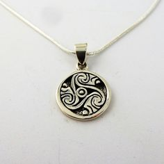 Sterling Silver Celtic Triskele pendant on an by celtictreasures