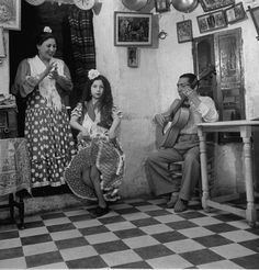 Gypsy (Roma) family. Look at the girl's foot, stepping into her dance.