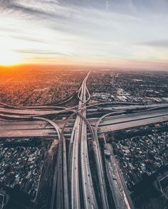 Creative Director and photographerDylan Schwartz's point-of-view is high above the cities he photographs, capturing the bridges, sports complexes, and tips of high rises from the cockpit of a helicopter. Most of Schwartz's imagesfeature his hometown of LA as the subject, showcasing views from Holl
