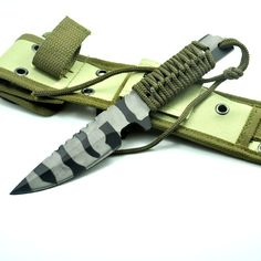 High Quality Tactical Knife Fixed Blade, very cool knife. Camo paint and para cord handle. Great for hunting and fishing.