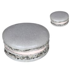 Grey macaron shells filled with a light cream infused with pink pepper ...