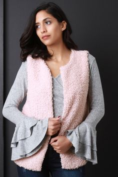 This sleeveless vest features a plush curl texture knit construction, seamless open front with hook-n-eye clasp closure, hidden side pockets, and fully lined. Accessory sold separately. 100% Polyester. Measurement Size Bust Hem Length S 34 18 26 M 36 19 27 L 38 20 28 Summer Crop Tops, Knit Vest, Sleeveless Tops, Lace Tops, Curls, Plush, Construction, Closure, Pockets