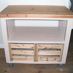 Kitchen island with crates....like this idea for storing potatoes and onions.