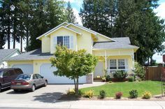 I have always loved yellow homes with white trim. =)